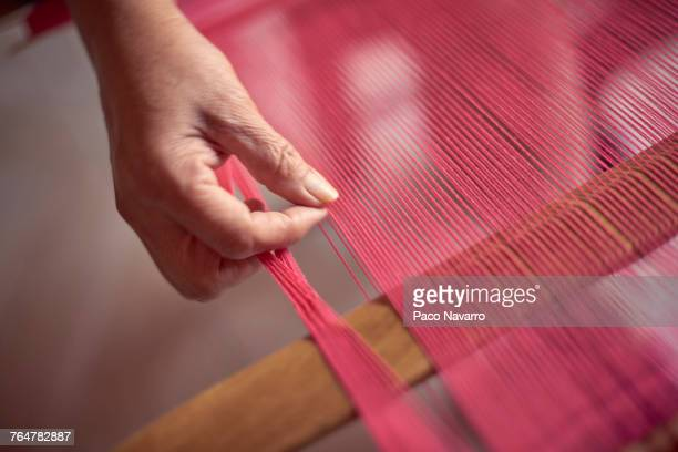 hand of hispanic woman weaving fabric on loom - loom stock pictures, royalty-free photos & images