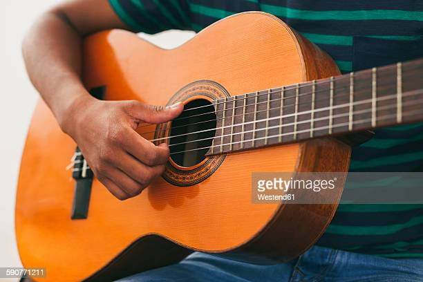 hand of man playing guitar - classical guitar stock photos and pictures