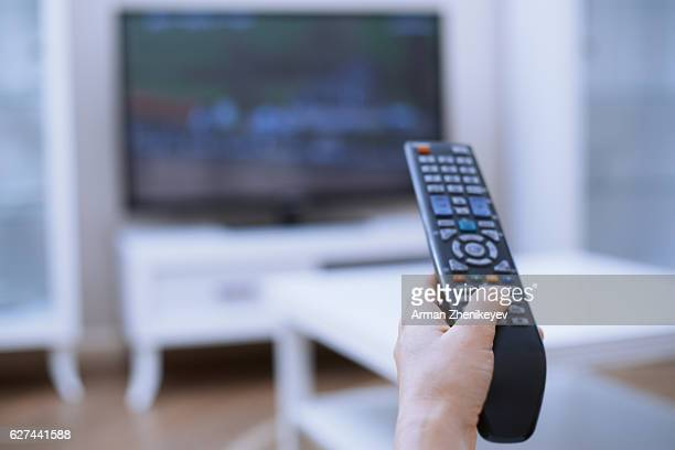 Hand of man with remote control