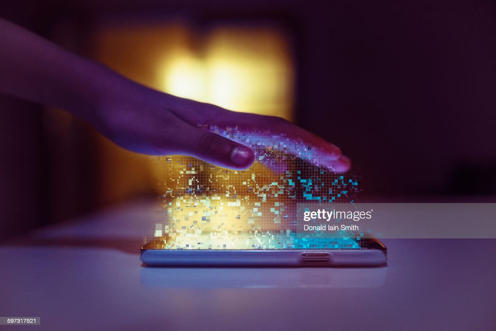 Hand of mixed race communicating with cell phone