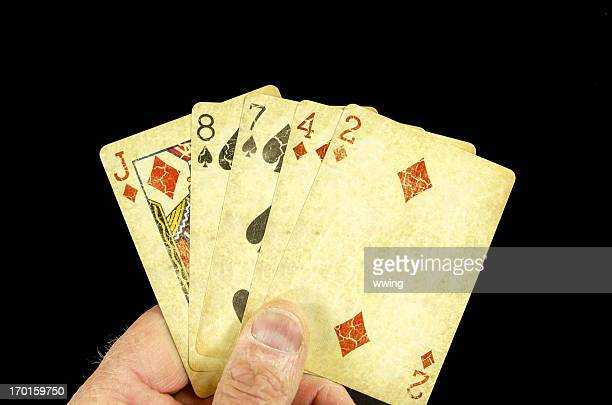 hand of poker cards... losing - hand of cards stock photos and pictures