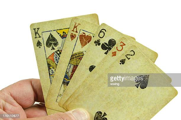 hand of poker cards... pair - hand of cards stock photos and pictures