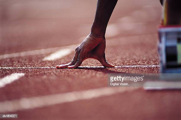 hand of runner at starting blocks - athlete stock pictures, royalty-free photos & images