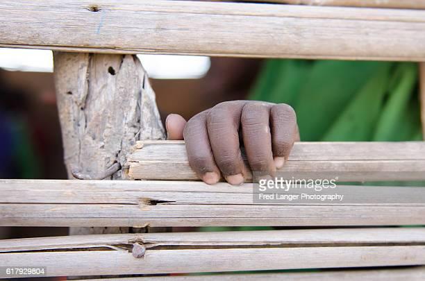 Hand of schoolboy in Africa
