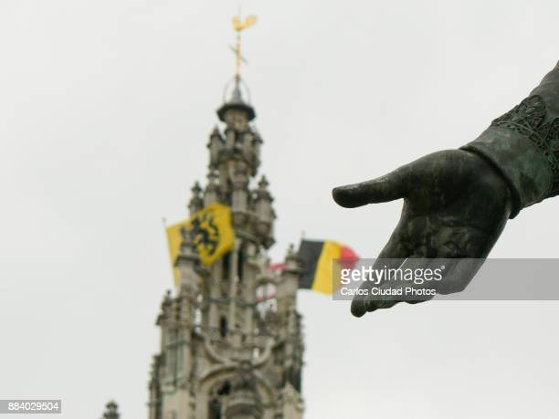 Hand of sculpture showing the flags of Belgium and Flanders in Antwerp