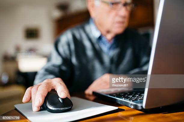 hand of senior man using mouse, close-up - computer mouse stock pictures, royalty-free photos & images