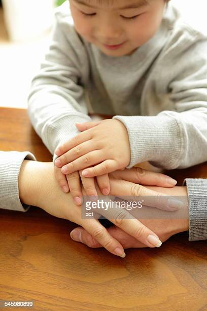 Hand of the family with baby boy