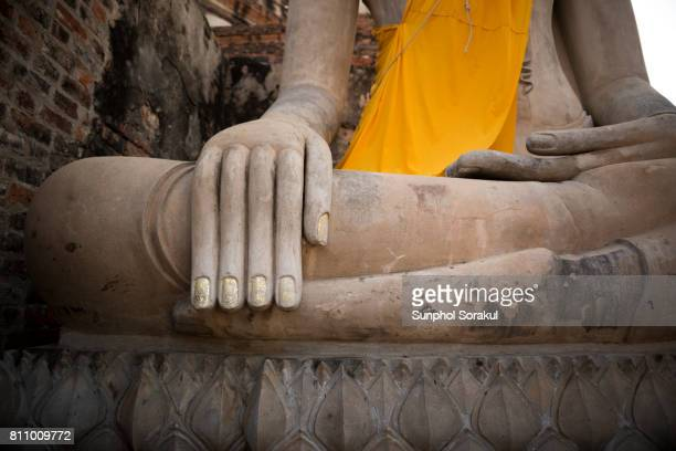 Hand of the large buddha statue in front of the pagoda at Wat yai Chai mongkhol