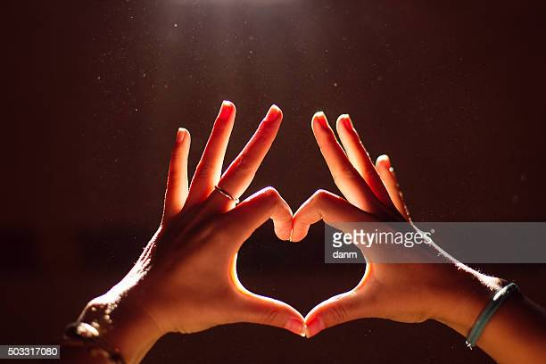 Hand of the woman who made the heart by hand