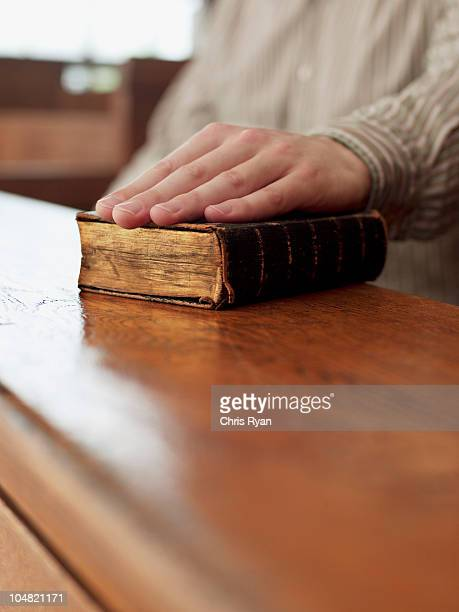 hand of witness on bible in courtroom - witness stock pictures, royalty-free photos & images