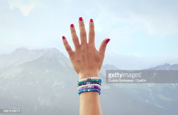 hand of woman against sky - bracelet stock pictures, royalty-free photos & images