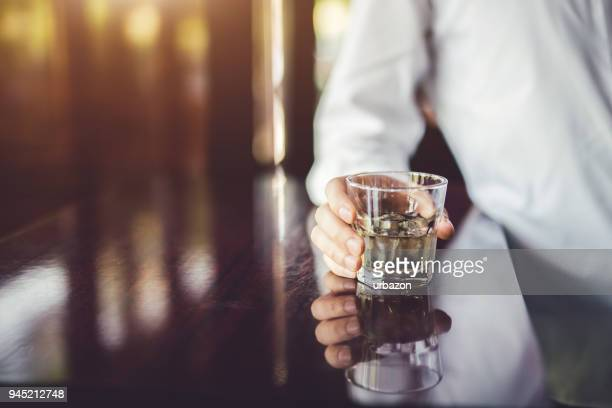 hand of young stylish caucasian man in cafe with his favorite alcohol drink. - vodka stock pictures, royalty-free photos & images