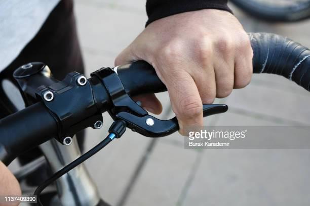 hand on bike handle and brake - 取っ手 ストックフォトと画像