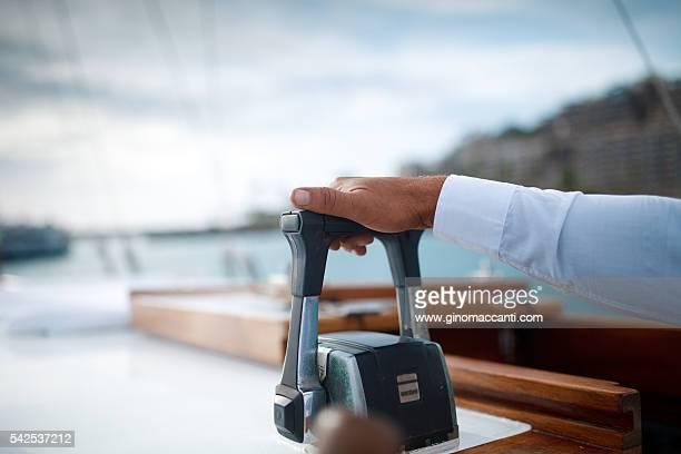 hand on boat accelerator throttle