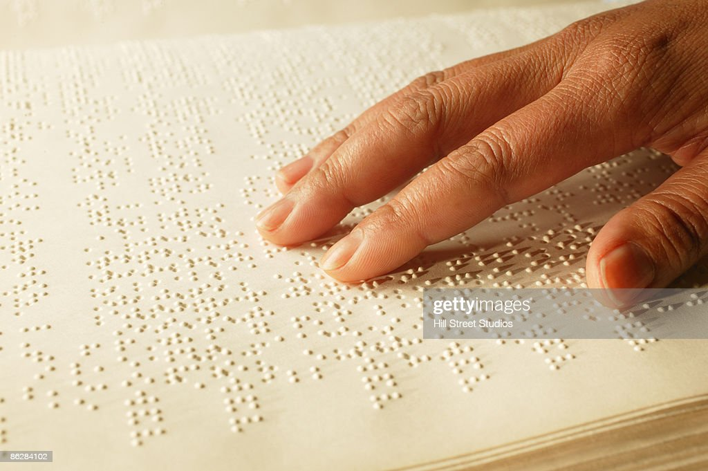 Hand on Braille book : Stock Photo
