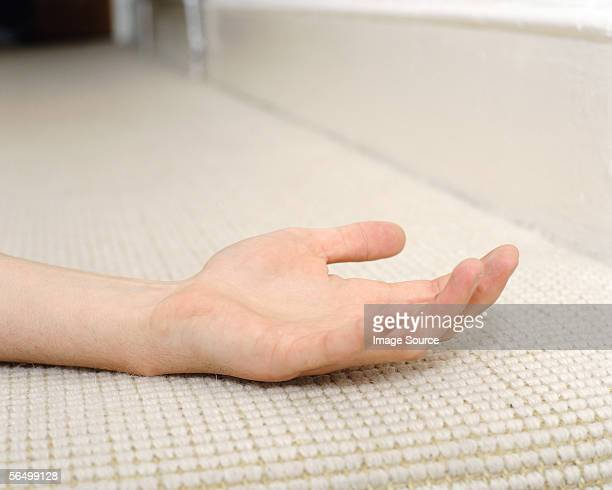 hand on carpet - unconscious stock pictures, royalty-free photos & images