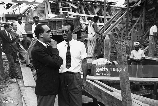 Hand on chin Brazilian architect Oscar Niemeyer on the site of an office block in Rio de Janeiro for the weekly illustrated paper 'O Cruzeiro'...