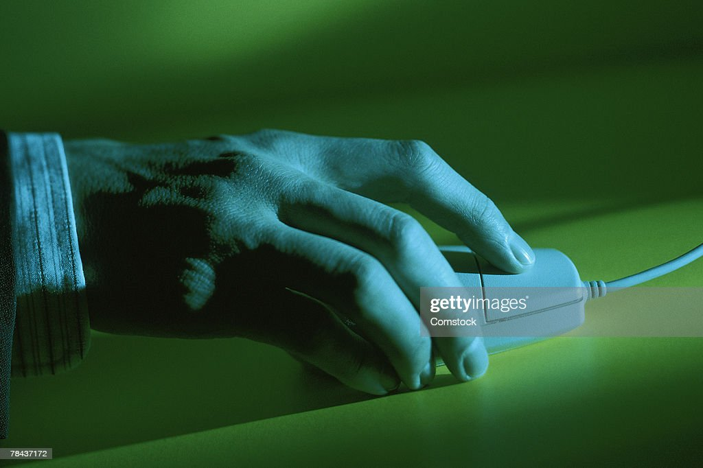 Hand on computer mouse : Stockfoto