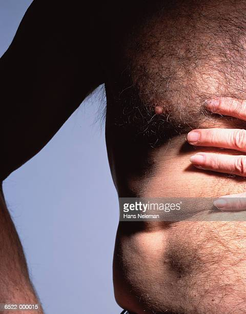 hand on hairy chest - female hairy chest stock pictures, royalty-free photos & images
