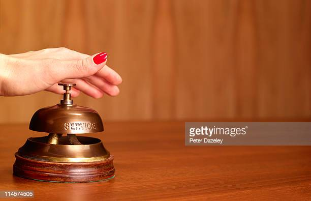 hand on hotel reception bell - returning stock pictures, royalty-free photos & images