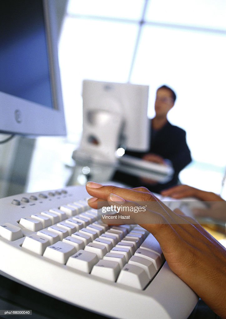 Hand on keyboard, close-up : Stockfoto