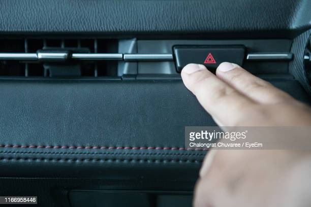 Hand On Man Touching Push Button On Dashboard In Car