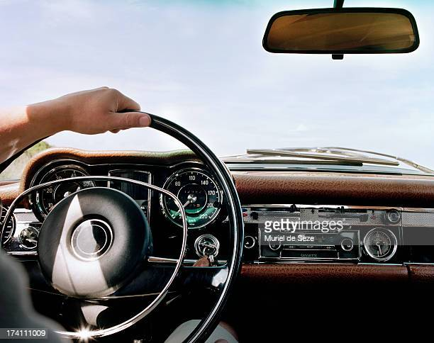 hand on steering wheel - vintage car stock pictures, royalty-free photos & images