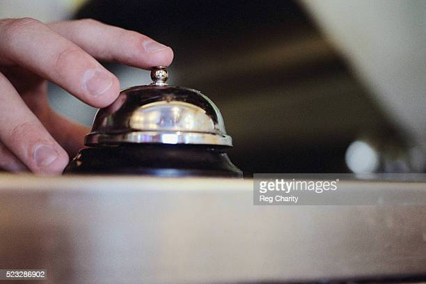 Hand on Table Bell