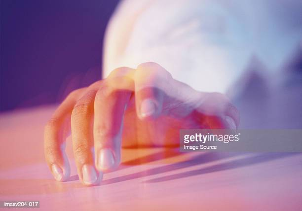 Hand on table
