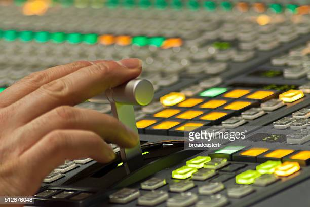 Hand on video mixer console