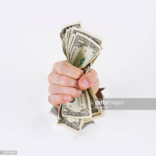 Hand on white background holding banknotes