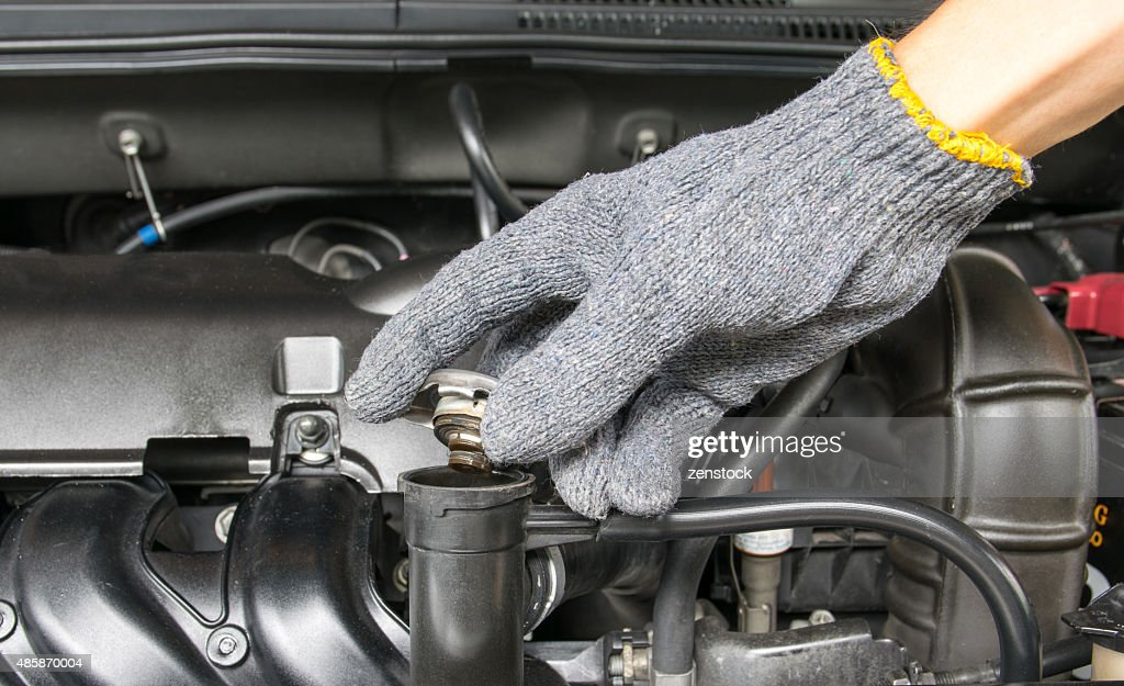 hand open valve metal cover on an radiator : Stock Photo