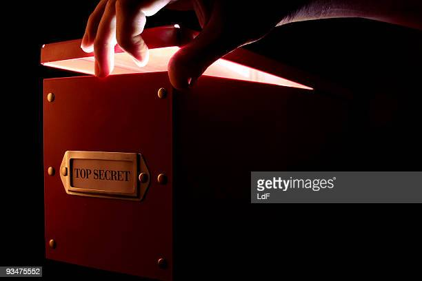 Hand opening a box in the dark