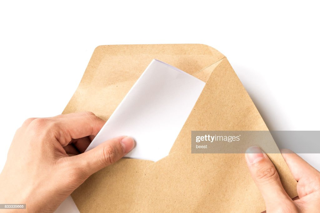 hand opening brown Document Envelope with paper : Stock Photo