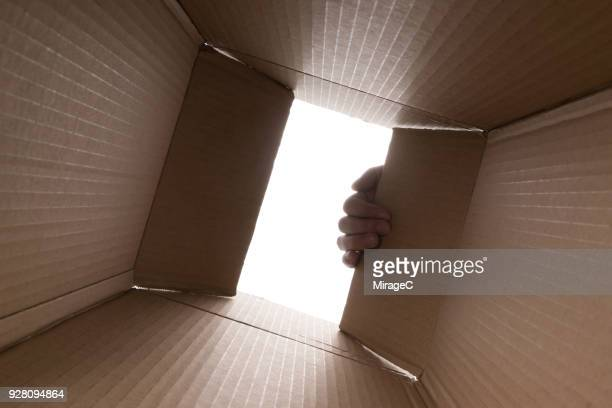 hand opening cardboard box - help:contents stock pictures, royalty-free photos & images