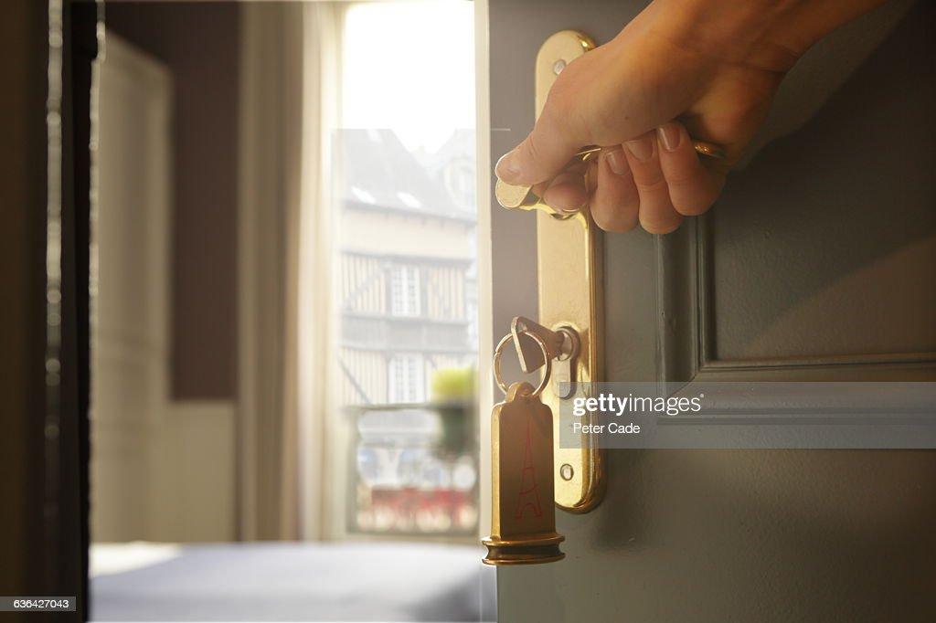 Hand opening hotel room door view through balcony  Stock Photo & Hand Opening Hotel Room Door View Through Balcony Stock Photo ...