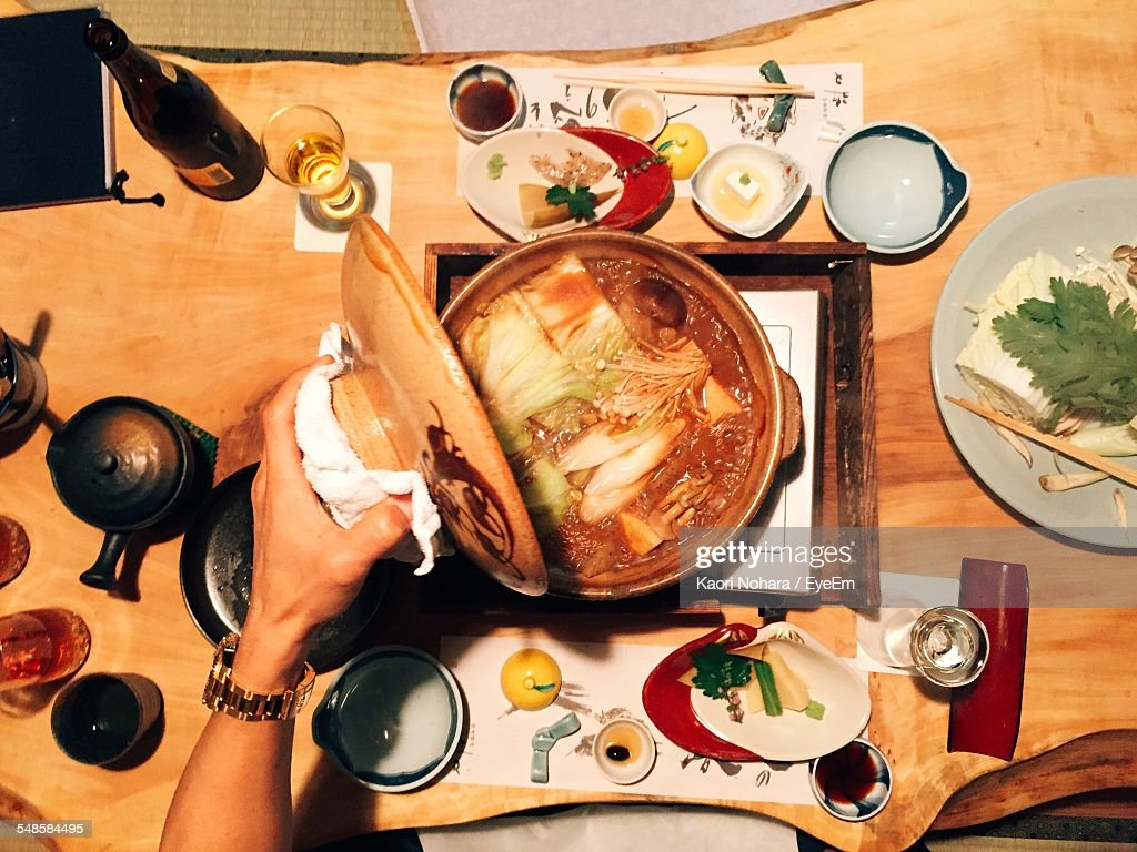 Hand Opening Pot With Soup : Stock Photo