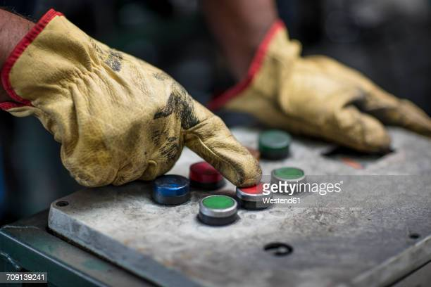 hand operating control panel - work glove stock photos and pictures