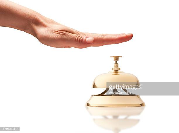 Hand over service bell on white background
