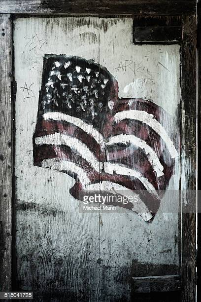 Hand painted American flag on wooden door