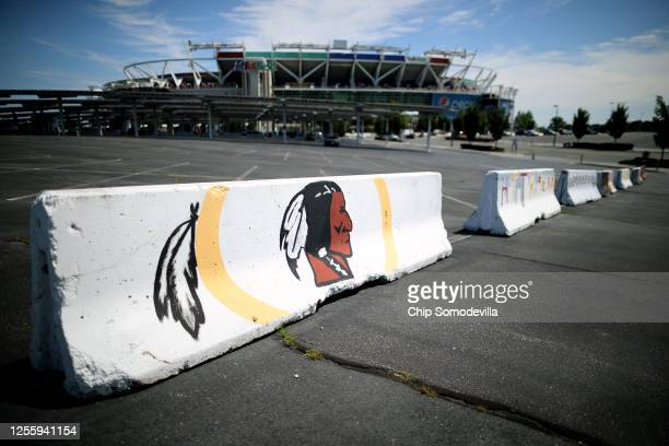 Hand painted concrete barriers stand in the parking lot of FedEx Field home of the NFL's Washington Redskins team July 13 2020 in Landover Maryland...