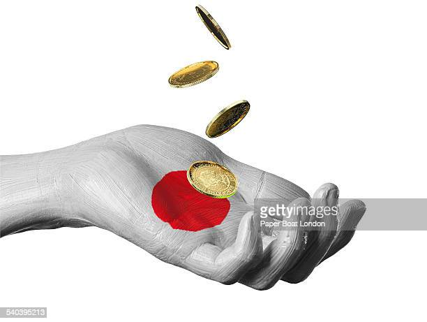 hand painted flag of japan with gold coins - japanese flag stock photos and pictures