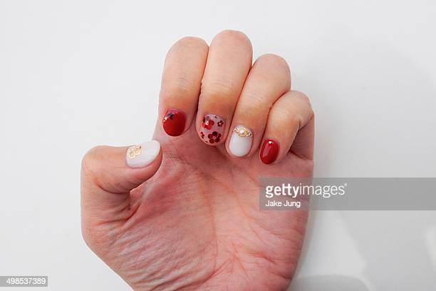 Hand painted floral nail art with red theme