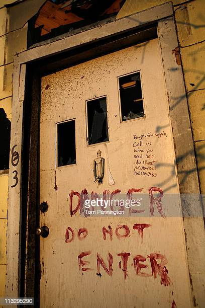 Hand painted warning on the door of a destroyed home on April 30, 2011 in Tuscaloosa, Alabama. Alabama, the hardest-hit of six states, is reported to...