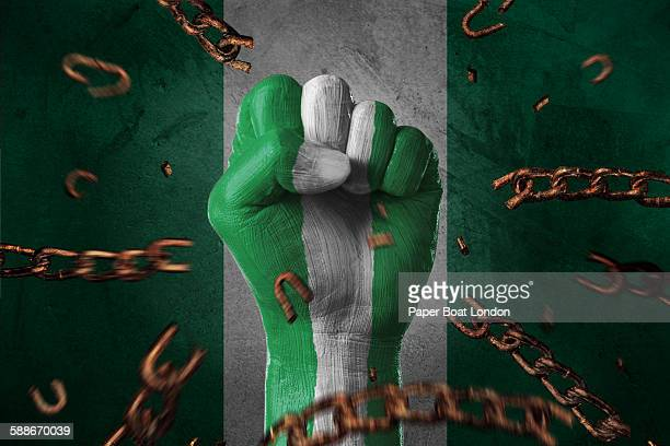 hand painted with flag of nigeria,loose chains - nigerian flag stock photos and pictures