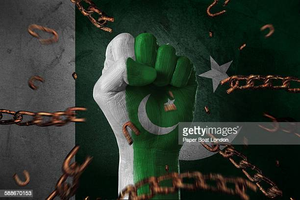 hand painted with flag of pakistan,loose chains - pakistani flag stock photos and pictures