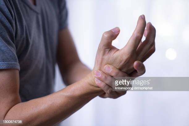 hand pain,young men have arm pain - finger stock pictures, royalty-free photos & images