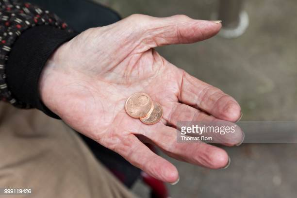 Hand, palm of an elderly man holding two five-cent coins, nursing home, retirement home, Berlin, Germany