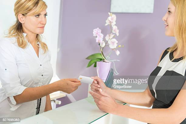 Hand passing a payment card