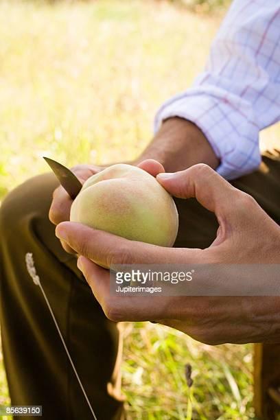 Hand peeling apple with knife